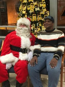 Man at a heavier weight with Santa Claus