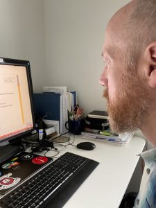 Doctor looking at computer during a telehealth visit.