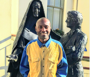 Man in front of statue