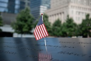 American flag inserted into lettering at memorial